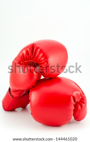 Two boxing gloves resting on each other, all picture is in focus and high key background.  - stock photo