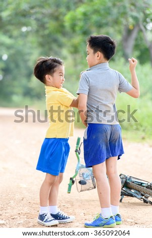 Two boy angry and figthing by punch on the other on the urban road during summer time.. - stock photo