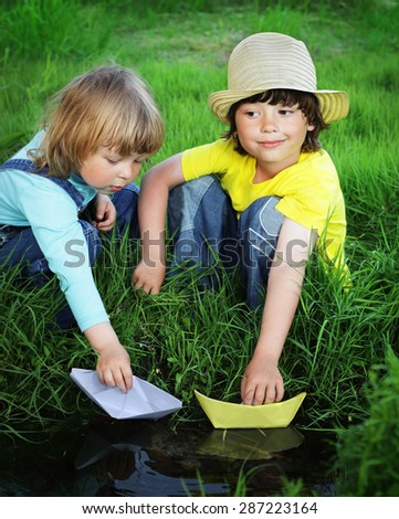 two  boy play in  stream - stock photo