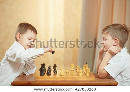 Two boy playing chess - stock photo