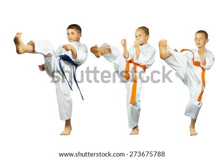 Two boys and a girl beat a foot in the air  - stock photo