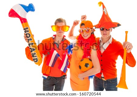 two boys and a girl, dressed for kings day  - stock photo