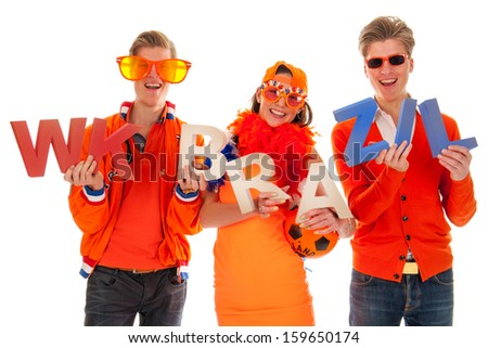 two boys and a girl, the supporters of the dutch soccer team. - stock photo