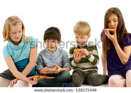 Two Boys and Two Girls Eating Pizza isolated on white background - stock photo