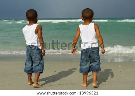 Two Boys at the Beach - stock photo