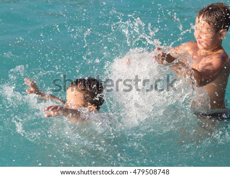 two boys bathing in the water park