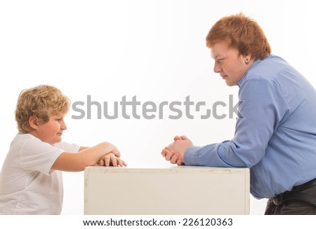 two boys brothers and friends  studio portrait on white background playing