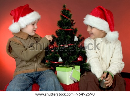 two boys decorating the christmas tree