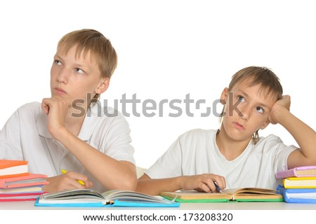 Two boys do their homework together