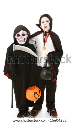 Two boys dressed as monsters for Halloween.  Full body isolated on white.