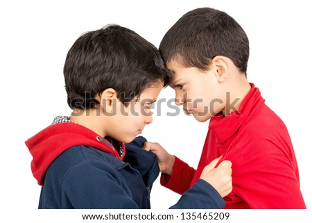 Two boys fighting isolated in white