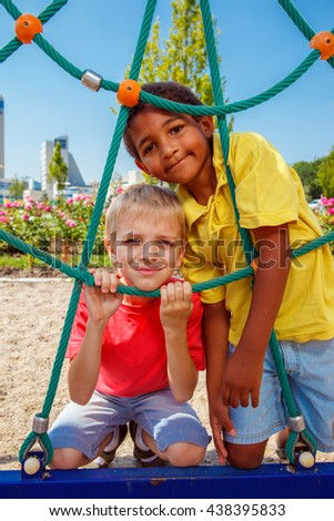 Two boys having fun at the outdoor playground