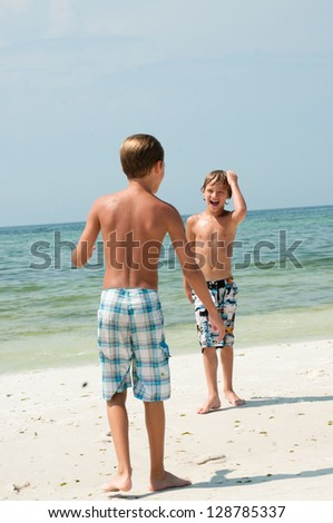 Two boys having fun on the beach.