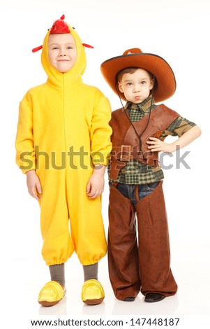 Two boys in costumes -in cowboy and in the chicken
