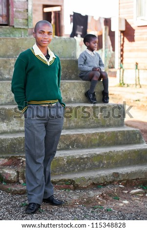 Two boys in front of their home - stock photo
