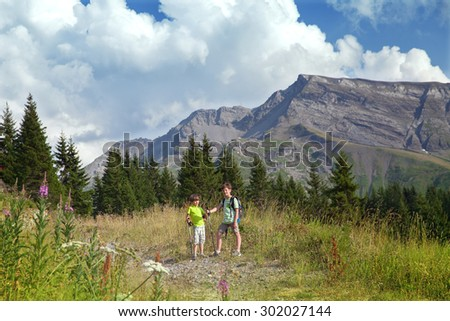 two boys in summer mountains