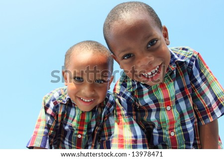 Two Boys Looking Down and Smiling - stock photo