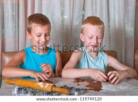 two boys making gingerbread cookies