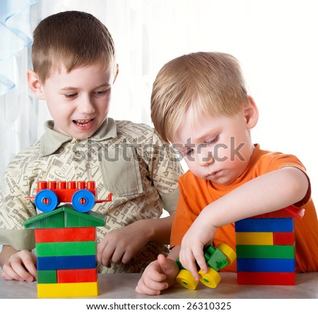 Two boys play on a white background - stock photo