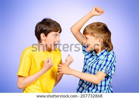 Two boys quarreled. Studio shot. - stock photo