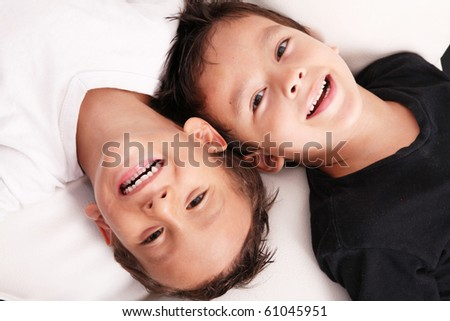 Two boys smiling and looking at the camera