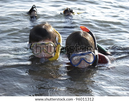 two boys snorkling in the ocean - stock photo
