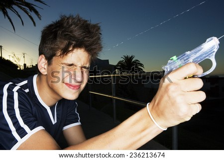 Two Boys Squirting Water Pistols - stock photo