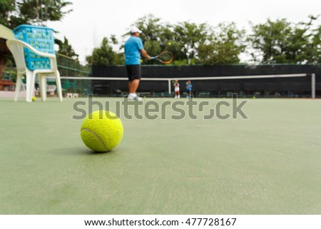 Two Boys Students are Learning Tennis with The Trainer