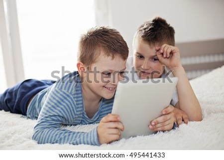 Two boys using a digital tablet