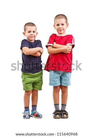 Two boys with arms crossed, isolated on white background - stock photo