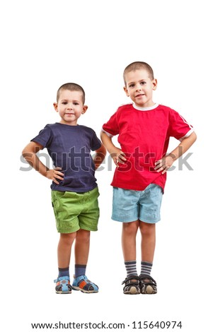 Two boys with arms on hip, isolated on white background - stock photo