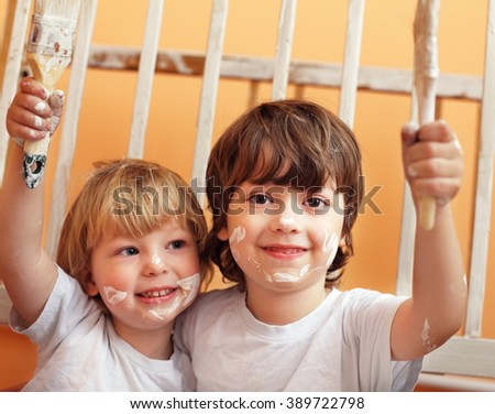 two boys with brush - stock photo