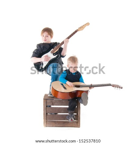 two boys with guitars on a box over white background