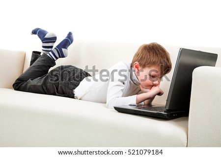 Two boys with laptop on the sofa