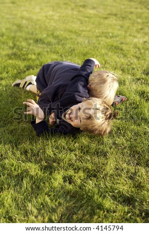 Two boys wresting and having fun - stock photo