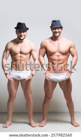Two brawny guy on a light background.  - stock photo