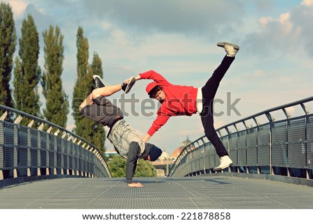 Two breakdancers dancing breakdance on the street - stock photo
