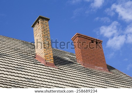 Two brick chimneys - stock photo