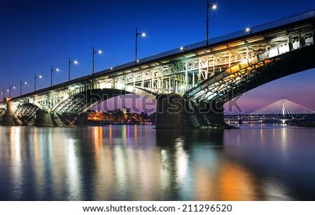 Two bridges illuminated in Warsaw.Poniatowski bridge and Swietokrzyski - stock photo