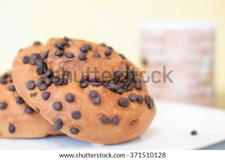 Two brioches with chocolate drops - stock photo