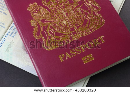 Two British EU Biometric Passports - one closed and one open - stock photo