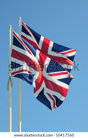 Two British flags on blue sky