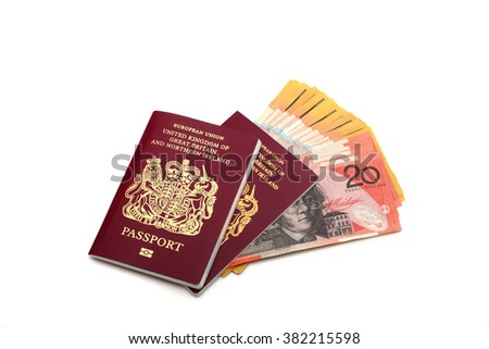 Two British passports and Australian 50 and 20 Dollar bills on a white background