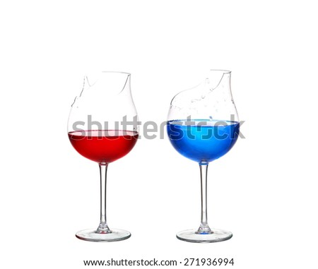 Two broken glasses with red and blue cocktail on white isolate - stock photo