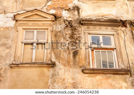 Two broken windows on old Lvov house in historic district - stock photo