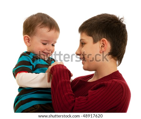 Two brothers are playing with their hands; isolated on the white background
