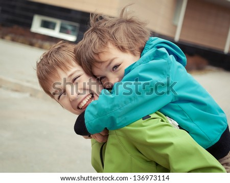Two brothers laugh, outdoor - stock photo