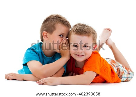 Two brothers lying down, talking. - stock photo