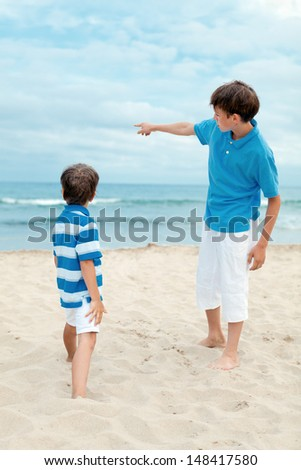 Two brothers on walk near sea, outdoor - stock photo
