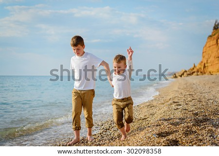 Two brothers playing on the beach